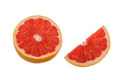 一个整个圆的片断和葡萄柚半片断在白色背景的 库存照片