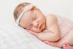 一个新出生的女孩的甜面孔 库存照片