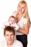 一个新愉快的系列的纵向: 母亲、父亲和婴孩微笑 库存图片