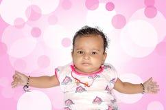 一个新生儿婴孩的画象 免版税库存图片