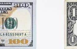 一个新的100美金和一美元的宏观射击 免版税库存照片