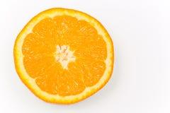 一个新鲜的桔子的一半在白色背景的 库存照片