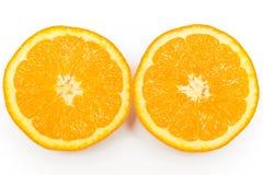 一个新鲜的桔子的两个一半在白色背景的 免版税库存照片