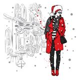 一个时髦的冬天外套和圣诞老人帽子的美丽的女孩 也corel凹道例证向量 库存例证