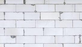 一个最近建造的房子的白色块砖 免版税库存照片