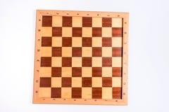 一个木棋盘的黑暗和明亮的正方形 图库摄影