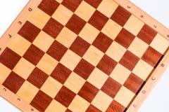 一个木棋盘的黑暗和明亮的正方形 免版税库存照片