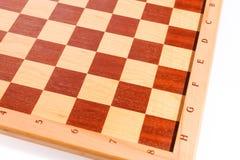 一个木棋盘的黑暗和明亮的正方形 库存图片