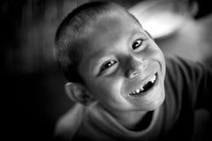 一个未认出的无牙的Ashà ¡ ninka孩子的照片 免版税库存图片