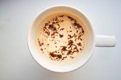 一个杯子热奶咖啡或香草拿铁 图库摄影