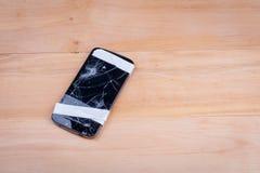 一个残破的电话基于一个木地板 免版税库存图片