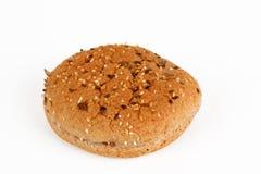 一个汉堡的一个小圆面包与五谷 库存照片
