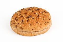 一个汉堡的一个小圆面包与五谷 图库摄影