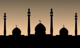 一个清真寺的黑剪影日落背景的 库存照片