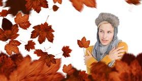 戴一个温暖的帽子的可爱的金发碧眼的女人的综合图象 免版税库存图片