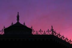 一个演奏台的剪影在日落的 图库摄影
