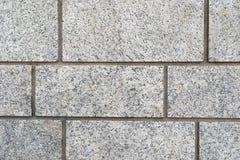 一个灰色花岗岩砖墙的背景纹理 图库摄影
