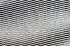 一个灰色破旧的塑料栅格的纹理 免版税库存图片