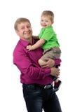 一个父亲和三岁的儿子的画象在演播室 库存图片