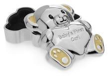 以一个玩具熊的形式银色箱子对第一个乳齿 免版税库存照片