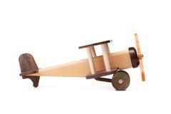 一个环境友好的产品的特写镜头儿童` s比赛的,隔绝在白色背景 一架开发的玩具飞机 库存图片