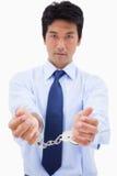 一个生意人的纵向与手铐的 免版税库存图片