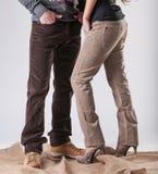 一个男人和一名妇女条绒裤子的 免版税库存照片
