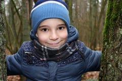 一个男孩的画象在森林里 库存图片