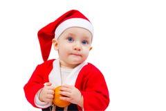 一个男孩的画象圣诞老人服装的  免版税库存图片