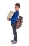 一个男孩的画象有教科书的 免版税库存照片