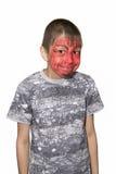 一个男孩的画象有被绘的面孔的 库存照片