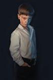 一个男孩的画象黑背景的 库存图片