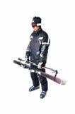 一个男性滑雪者陈列如何运载充分的设备 图库摄影