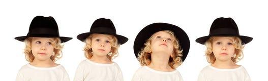一个白肤金发的孩子的序列有做differents expres的黑帽会议的 库存照片
