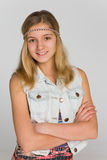 一个白肤金发的青少年的女孩的画象 库存照片