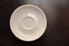 一个白色茶碟 库存图片
