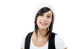 一个相当年轻浅黑肤色的男人的画象有冬天帽子的,在白色 免版税库存照片