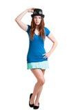 一个短裙和蒸汽废物帽子的女孩 免版税库存图片