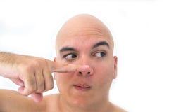 一个秃头人的面孔在白色背景中 库存照片