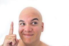 一个秃头人的面孔在白色背景中 库存图片