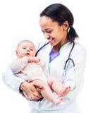 一个空白背景的医生和婴孩 免版税库存照片