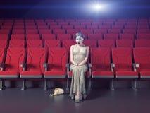 一个空的戏院的女孩 免版税库存照片