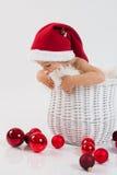 一个篮子的男孩在圣诞节时间 免版税库存照片