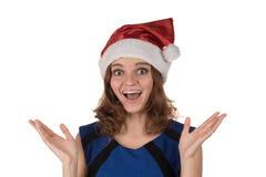 一个红色圣诞节帽子的女孩激动在他的另外滑稽的 免版税库存图片