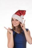 一个红色圣诞节帽子的女孩激动在他的另外滑稽的 免版税库存照片