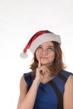 一个红色圣诞节帽子的女孩激动在他的另外滑稽的 库存图片