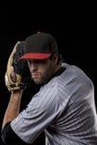 一个红色统一的棒球运动员。 库存照片