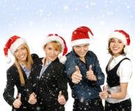 一个组圣诞节帽子的企业人员 免版税库存照片