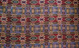一个美丽和五颜六色的手工制造波斯地毯 免版税库存图片