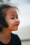 一个美丽的亚裔女孩的室外画象 免版税图库摄影